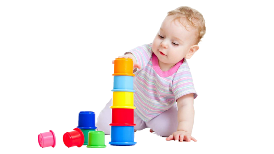 A toddler girl playing Stacking & Nesting Cups