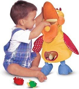 a toddler boy playing Melissa & Doug K's Kids Hungry Pelican