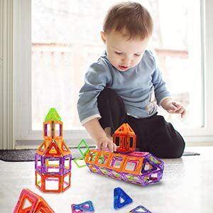 A toddler boy playing blocks