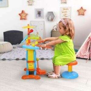 Benefits of musical instruments for toddlers-girl playing Drum Set