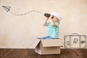 A boy sitting in a cardbox