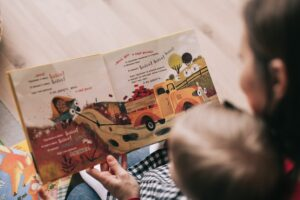 The importance of reading with toddlers-Woman Reading Book to Toddler