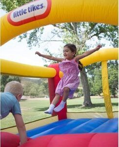 kids play in the inflatable bounce house