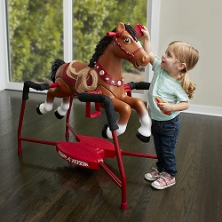 A girl play with Interactive Riding Horse