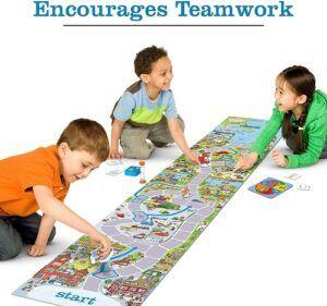 3 kids playing board game