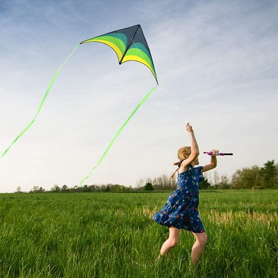a girl flying a kite